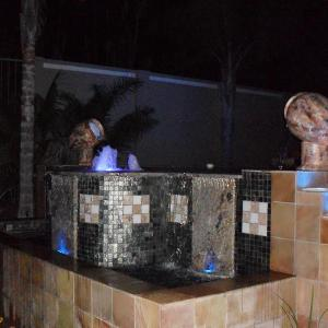021 - Conventional pool rimflow pool night feature with grey mosaic