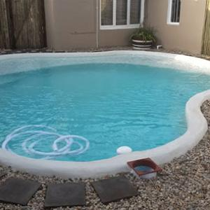 002 - Beach pool with pebble mix surround